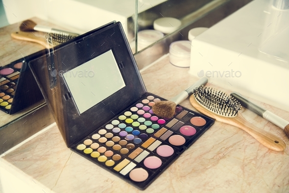 Makeup set and comb on table - Stock Photo - Images