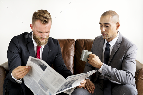 Two businessman sitting on a couch - Stock Photo - Images