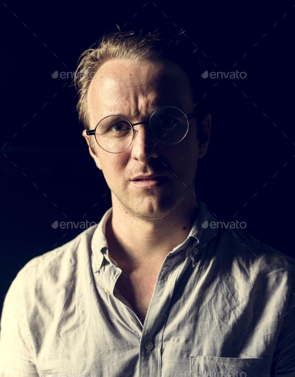 Caucasian man with eyeglasses look worried - Stock Photo - Images