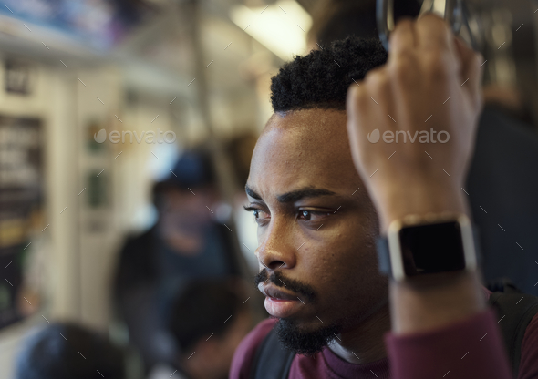 Man on a train - Stock Photo - Images