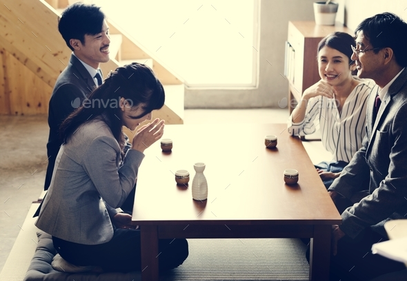 Japanese friends having a great time together - Stock Photo - Images