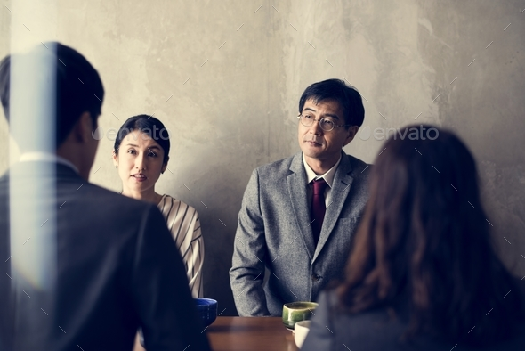 Japanse business people talking - Stock Photo - Images
