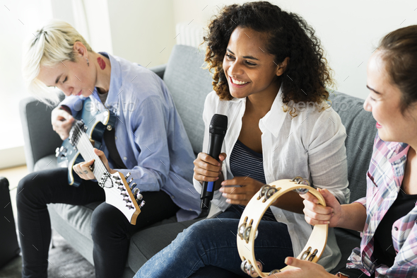 Group of people enjoying music icons - Stock Photo - Images