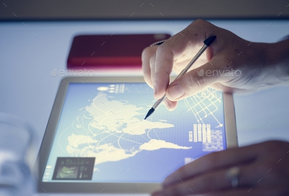 Hands holding using magic pen on tablet - Stock Photo - Images