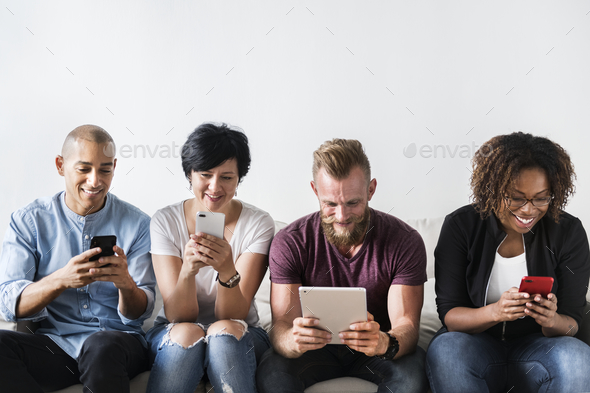 Group of diverse people using digital devices - Stock Photo - Images