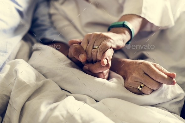 Closeup of couple holding hands together - Stock Photo - Images