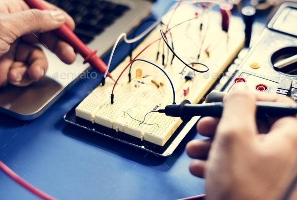 Closeup of multimeter measuring breadboard - Stock Photo - Images