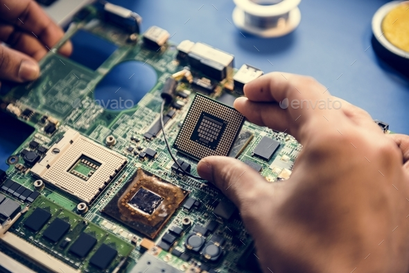 Closeup of hands with computer microprocessor - Stock Photo - Images