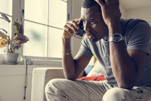 Black guy talking phone with angry emotion - Stock Photo - Images