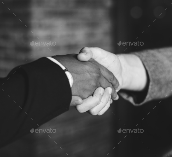 Businessmen shaking hands in a agreeement - Stock Photo - Images