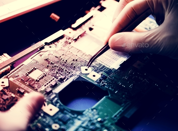 Closeup of hands working on computer motherboard - Stock Photo - Images
