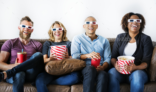 Group of friends watching movie - Stock Photo - Images