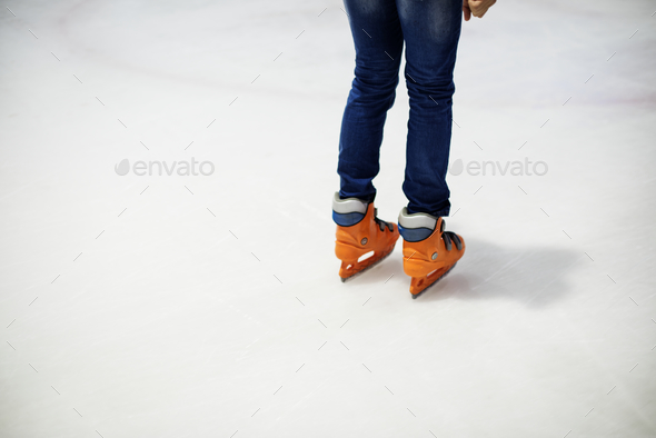 Ice skating on the ice rink leisure and fun lifestyle concept - Stock Photo - Images