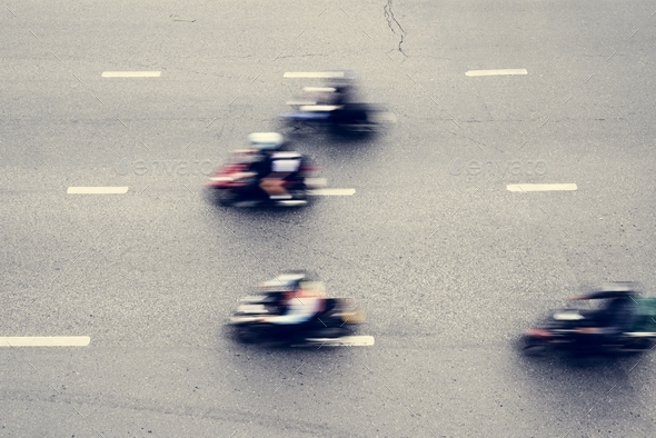 Aerial view of blurred motorbikes on the street in downtown - Stock Photo - Images
