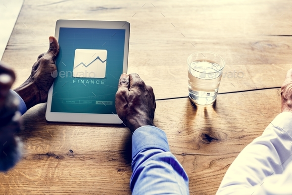 Hands holding tablet with statistic icon on screen - Stock Photo - Images