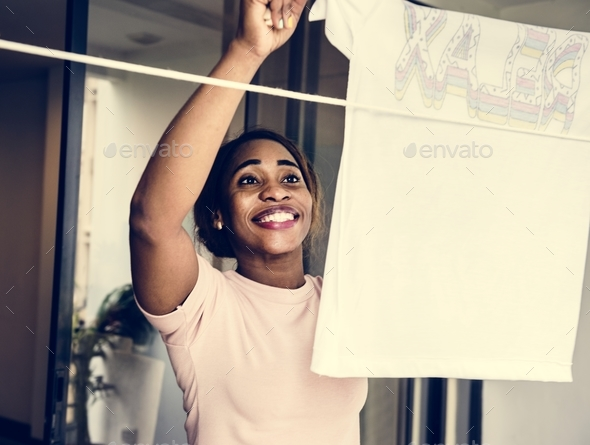 Closehup of black woman hanging washed clothes housework - Stock Photo - Images