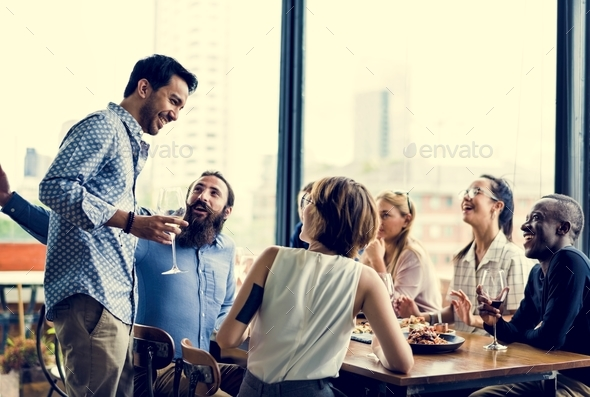 People having a meal together - Stock Photo - Images
