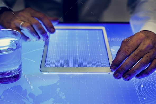 Hands on digital tablet on cyber space table - Stock Photo - Images