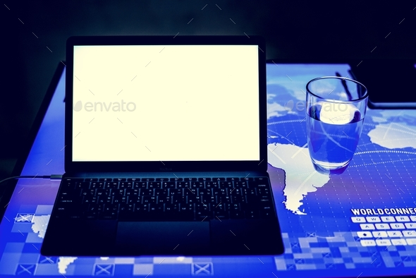 Laptop on a digital desk cyber space - Stock Photo - Images