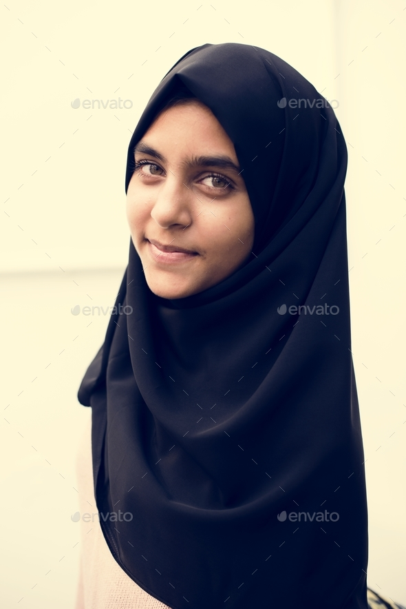 A cheerful Muslim woman - Stock Photo - Images