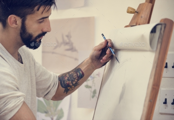 Man working on painting - Stock Photo - Images