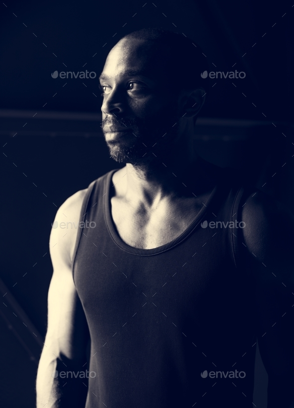 African ethnicity man with thoughtful face expression grayscale - Stock Photo - Images