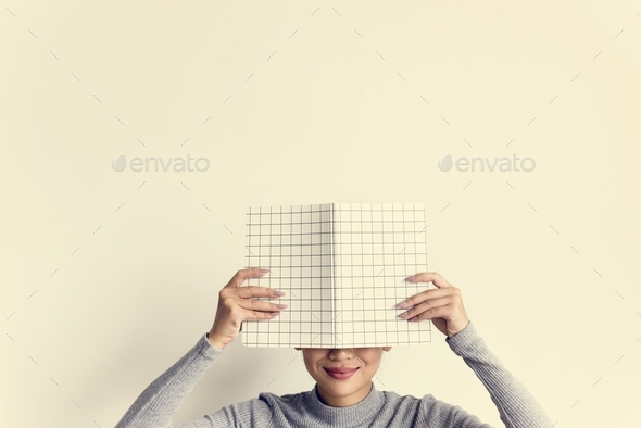 Woman face covered with notepad on white background - Stock Photo - Images