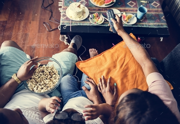 Family eating popcorn - Stock Photo - Images