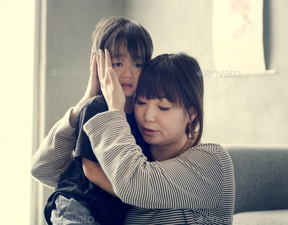 Japanese mother comforting her daughter - Stock Photo - Images