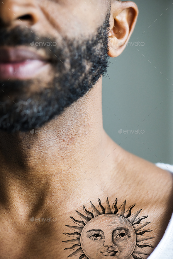 Closeup of collar bone tattoo of a man - Stock Photo - Images
