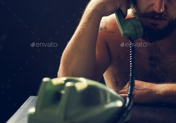 Man using telephone on tension talking - Stock Photo - Images