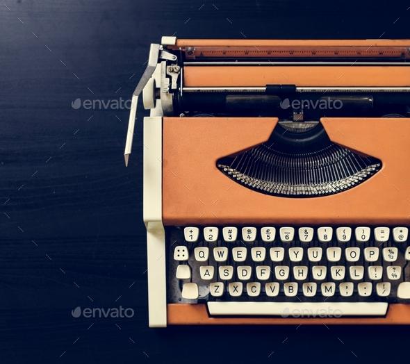 Retro orange typewriter - Stock Photo - Images