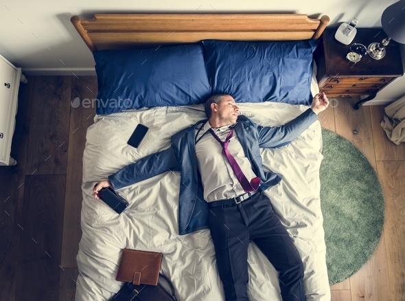 Drunk business man falling asleep as soon as he came back home - Stock Photo - Images