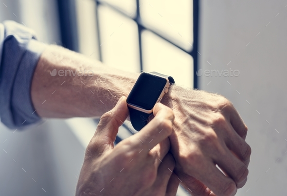 Businessman checking his smart watch - Stock Photo - Images