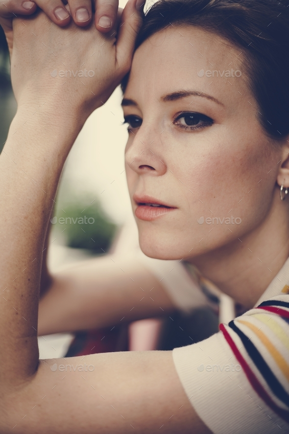 Young caucasian woman relaxing outside - Stock Photo - Images