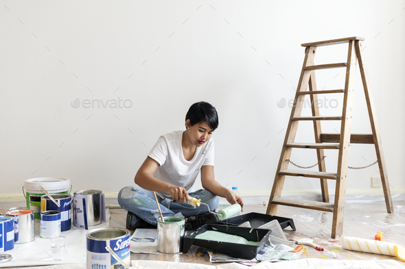 Woman renovating the house - Stock Photo - Images
