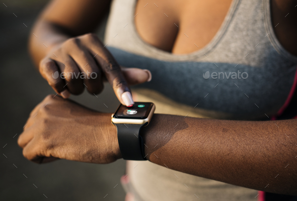 A woman wearing a smartwatch - Stock Photo - Images