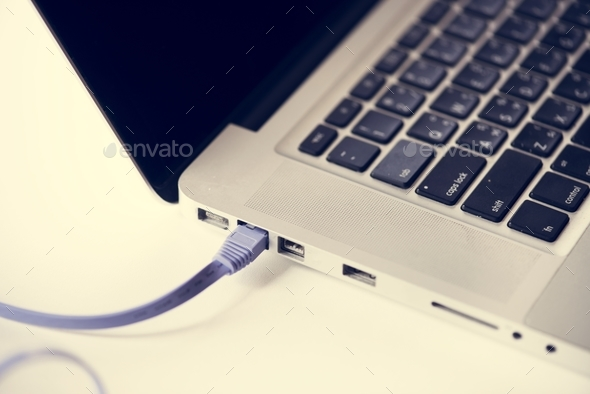 Lan cable connected to laptop - Stock Photo - Images
