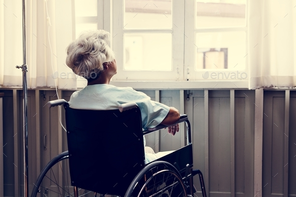 Old woman on a wheel chair - Stock Photo - Images