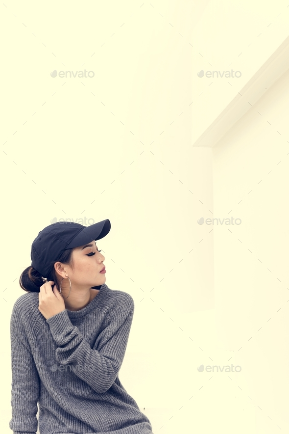 Closeup of asian woman wearing a cap - Stock Photo - Images