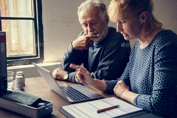 Elderly couple researching information online - Stock Photo - Images