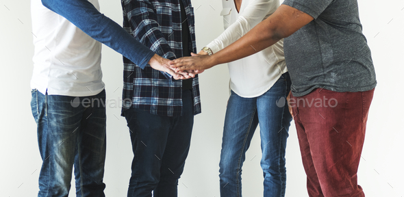 Diverse people joining hands together teamwork and community concept - Stock Photo - Images