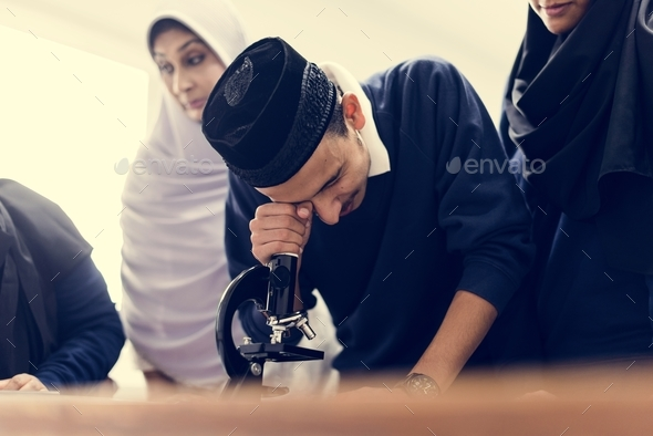 Muslim students in class - Stock Photo - Images