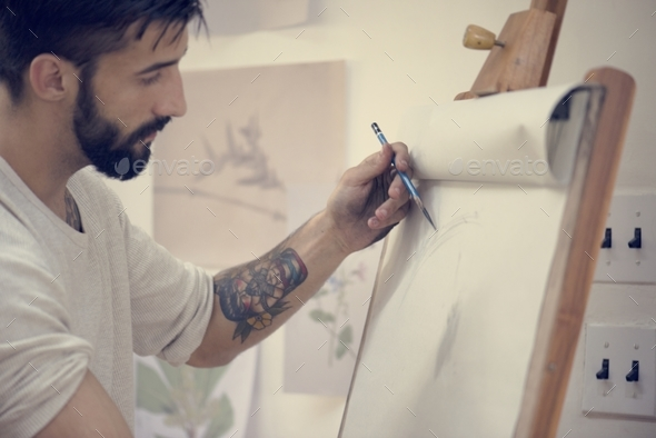 Man working on a painting - Stock Photo - Images