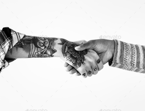 People shaking their hands together - Stock Photo - Images