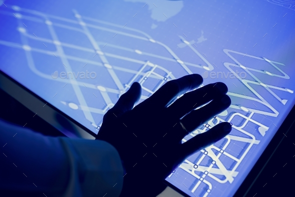 Hand on a cyber space table - Stock Photo - Images