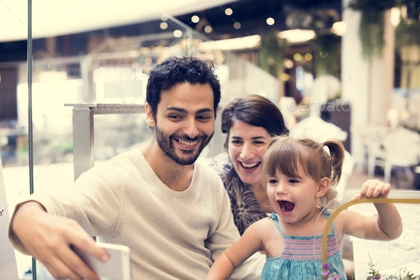 Family taking photo selfie together - Stock Photo - Images