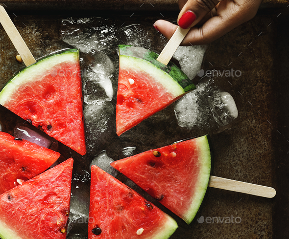 Freshly slice watermelon on sticks - Stock Photo - Images