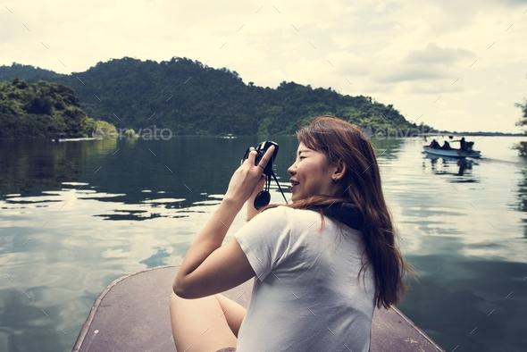 Asian woman enjoying an outdoor trip - Stock Photo - Images