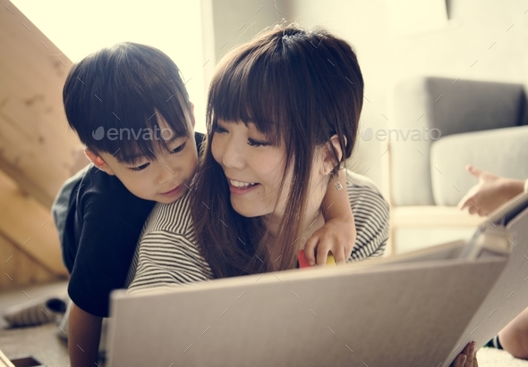 Japanese mother and son playing - Stock Photo - Images